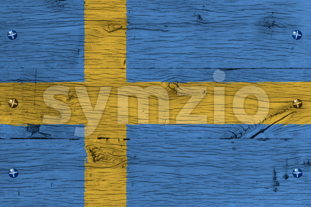 Kingdom of Sweden, Swedish national flag. Painting is colorful on wood of old train carriage. Fastened by screws or bolts.