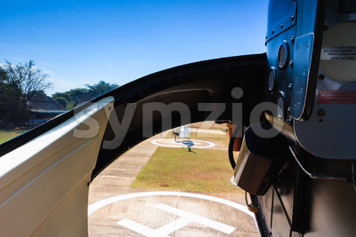 Helicopter landing from cabin Stock Photo