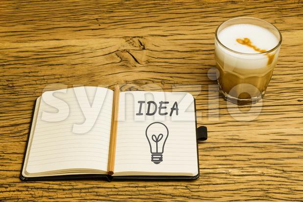 Concept idea lightbulb notebook plan coffee Stock Photo
