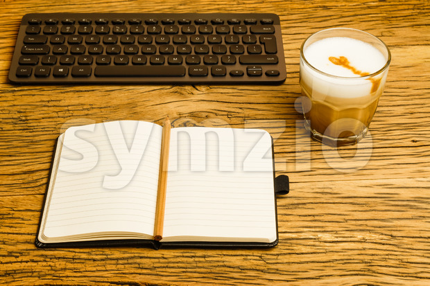 Concept empty notebook pencil keyboard start day Stock Photo