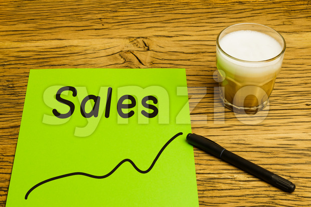 Sales graph green paper Stock Photo