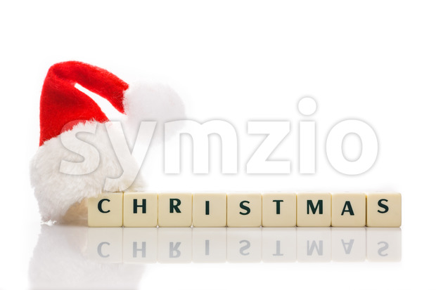 Christmas spelled text dice cubes hat santa Stock Photo