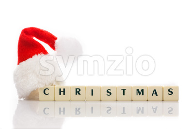 Christmas spelled text dice cubes hat santa Stock Photo