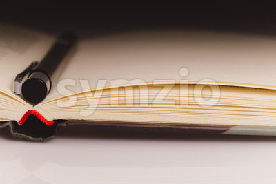 Book close up pencil partial light Stock Photo