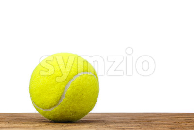 Single tennis ball table wood isolated Stock Photo