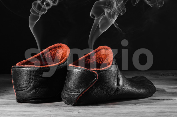 Empty slipper shoe smoke rise Stock Photo