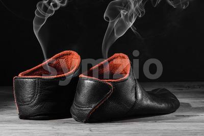 Empty slipper shoe smoke rise Stock Photo