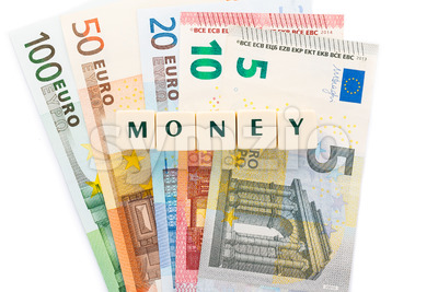 Several euro banknotes money text dice Stock Photo