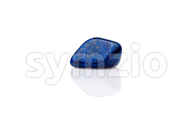 Beautiful blue lapis lazuli gem stone isolated Stock Photo
