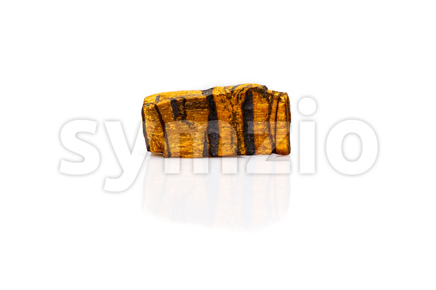 Tiger's eye gem stone rough isolated white Stock Photo
