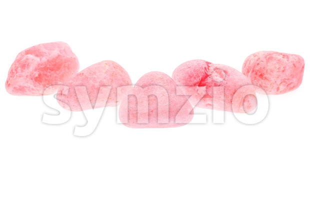 Several rough pink rose quartz isolated Stock Photo