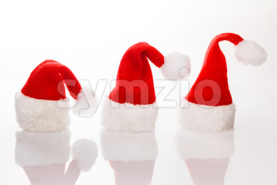 Three Christmas hats Santa row Stock Photo