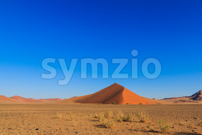 Blue sky above red sand dune landscape Sossusvlei Stock Photo