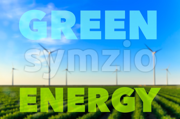 Windmills field crops green energy text Stock Photo