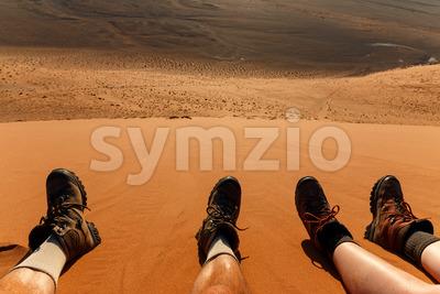 Enjoying resting climbing sand dune Stock Photo