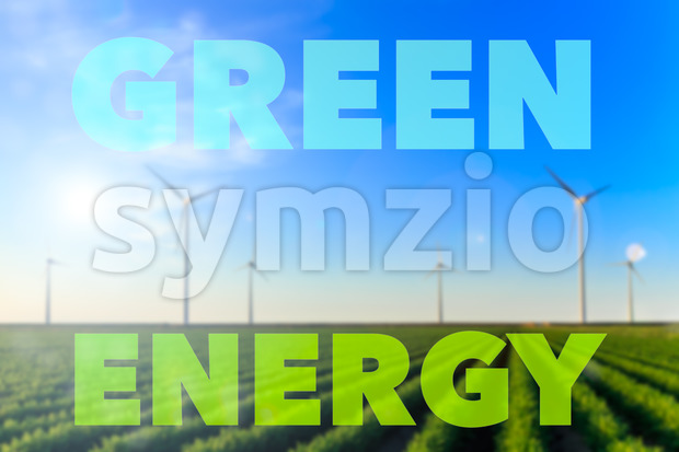 Windmills field crops green energy text flare Stock Photo