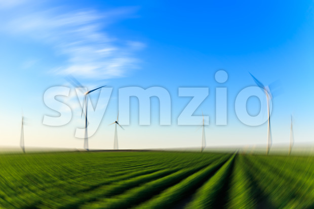 Windmills field of crops blur radial Stock Photo