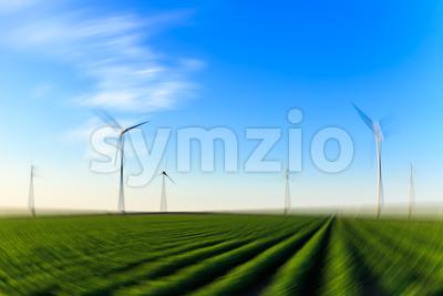 Windmills field of crops blur radial Stock Photo