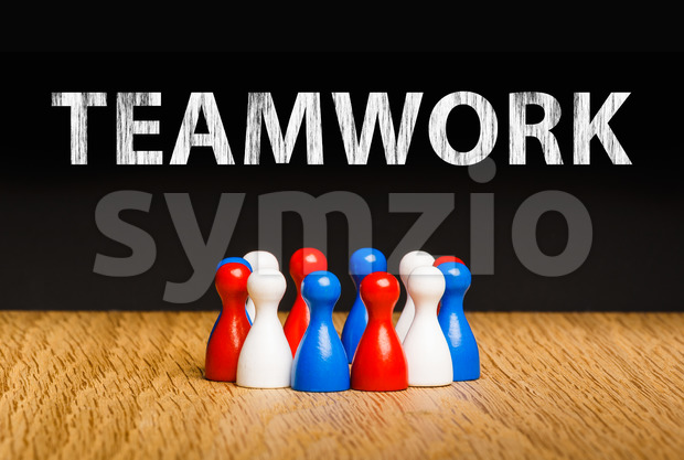Concept for teamwork red white blue chalk text white Stock Photo