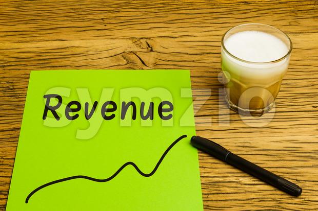 Revenue graph green paper Stock Photo