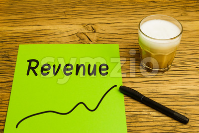 Revenue graph green paper Stock Photo