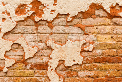 Close up brick wall broken plaster Stock Photo