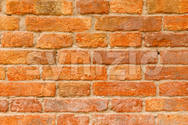 Old fashioned orange and red brick wall in Italy Europe