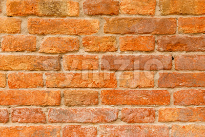 Old orange and red brick wall Stock Photo
