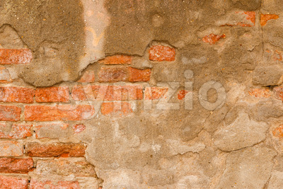 Orange brick wall with cement Stock Photo