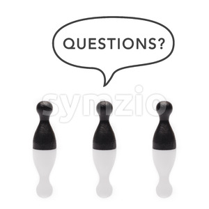 Black pawns say questions? text balloon Stock Photo