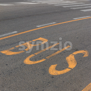 Text bus lane on road Stock Photo