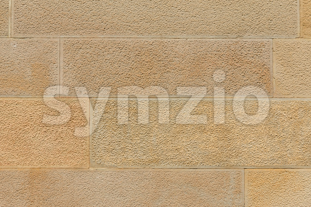 Big yellow stone wall close up Stock Photo