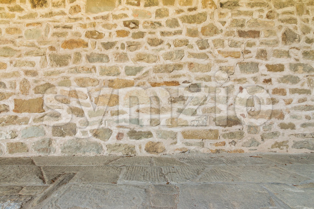 Rough medieval wall and floor of monastery Italy