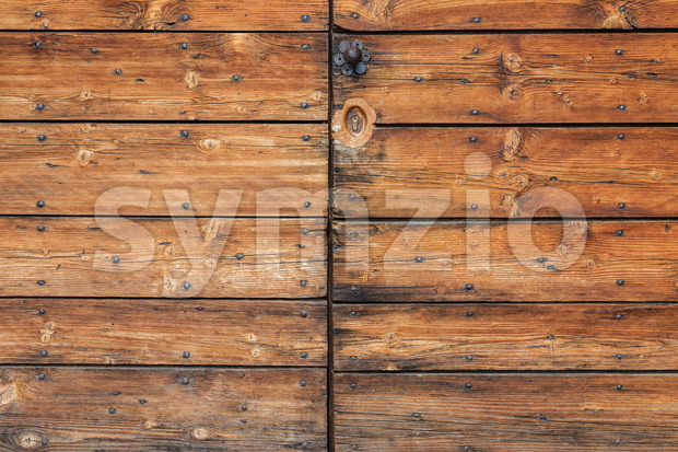 Old worn wooden door detail Stock Photo
