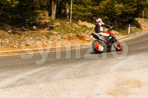Motorbike racing corner of road Stock Photo