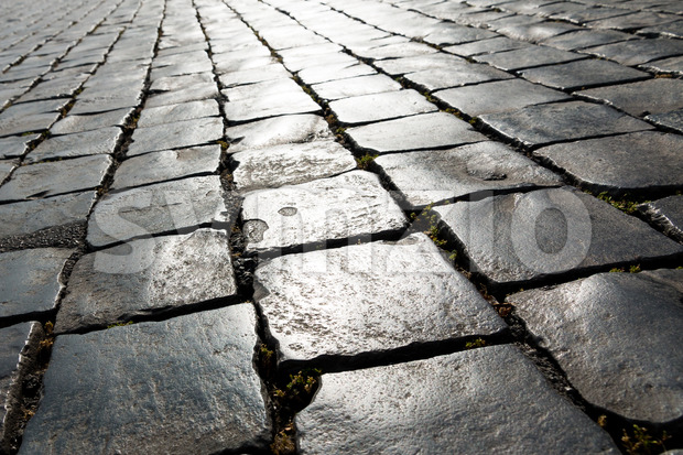 Angled pattern historic cobbled street Stock Photo