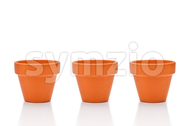 Three terracotta flower pots isolated on white Stock Photo