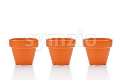 Three terracotta flower pots isolated on white Stock Photo