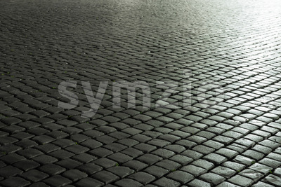 Old cobbled street evening light Stock Photo