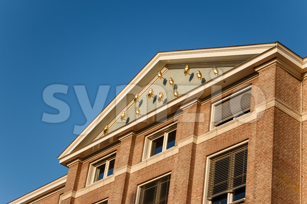 GRONINGEN, NETHERLANDS -NOVEMBER 01, 2014: Harmoniegebouw golden owls ode to Pallas Athena Stock Photo