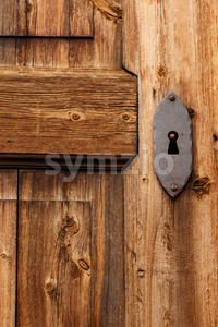 Close-up old wooden door keyhole Stock Photo