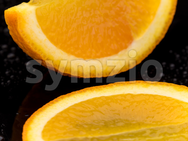 Close-up orange fruit on black surface Stock Photo