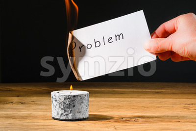 Concept solution probem by burning text on paper Stock Photo