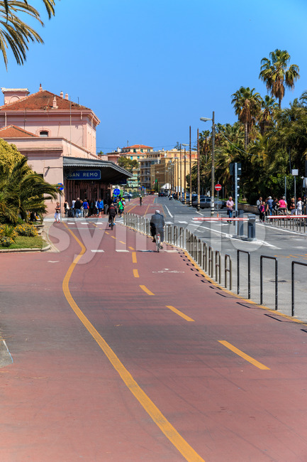 SAN REMO, ITALY - APRIL 29, 2016: People riding cicycle path nea Stock Photo