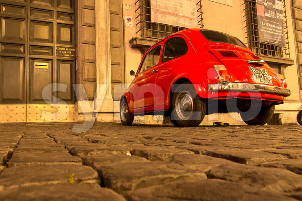 ROME, ITALY - MAY 10, 2016: Old red Fiat 500 on streets of Rome Stock Photo