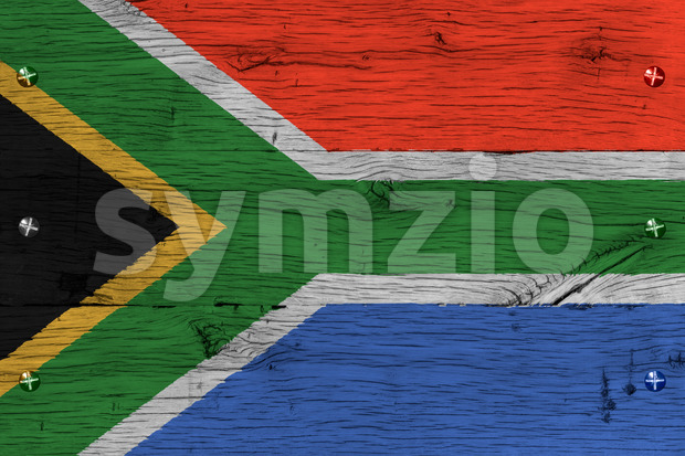 South Africa national flag painted on old oak wood. Painting is colorful on planks of train carriage. Fastened by screws ...