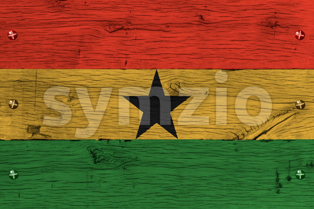 Ghana, Ghanese national flag painted on old oak wood. Painting is colorful on planks of train carriage. Fastened by screws ...