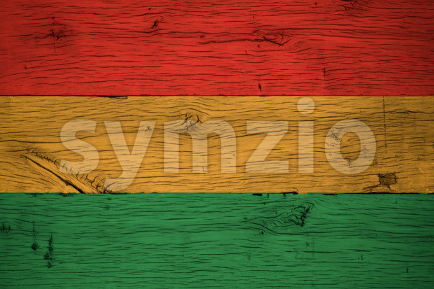 Bolivia civil flag painted on old oak wood. Painting is colorful on planks of old train carriage.