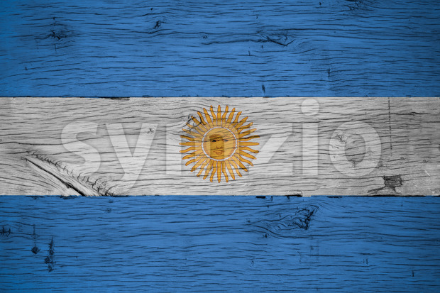 Argentina national flag painted on old oak wood. Painting is colorful on planks of old train carriage.