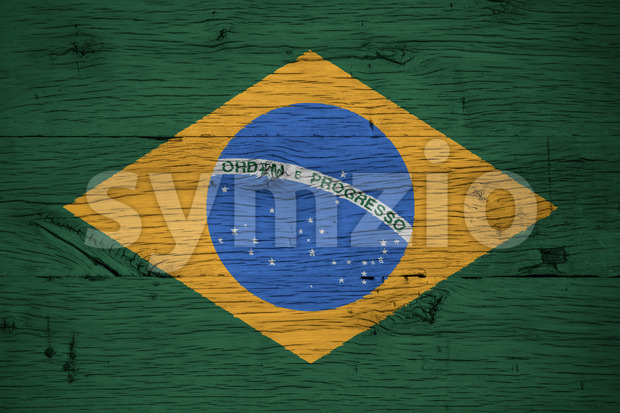 Brazil, Brazilian national flag painted on old oak wood. Painting is colorful on planks of old train carriage.